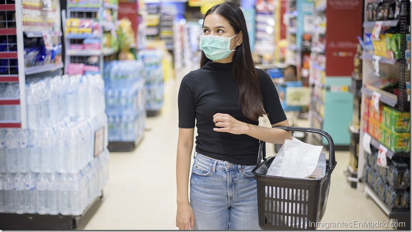 woman with face mask is shopping clothes in Shopping center