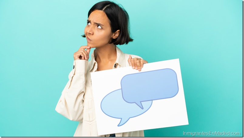 Young mixed race woman isolated on blue background holding a placard with speech bubble icon and thinking