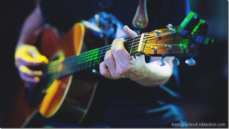 Stylish Acoustic Guitar Playing by hand. Artist